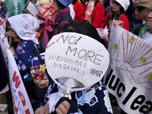 No! more Hiroshimas, handmade sign on fan, 2015.