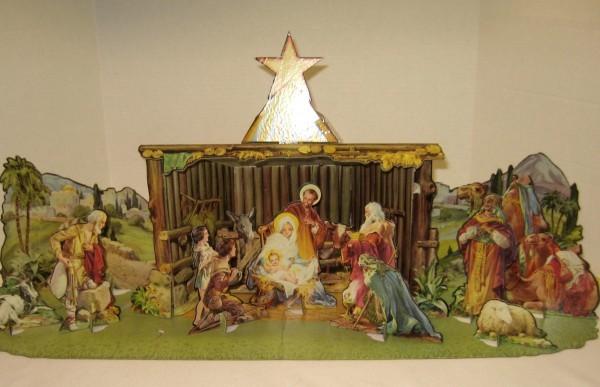 20th century with die cut cardboard nativity scene.